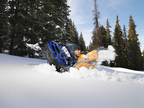 Man with stuck snowmobile. Stock photo © iofoto