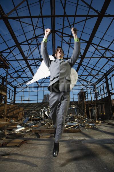 Businessman Wearing Angel Wings Stock photo © iofoto