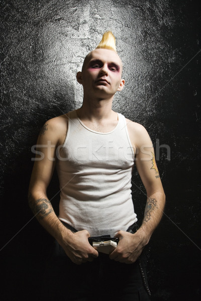 Punk holding buckle. Stock photo © iofoto