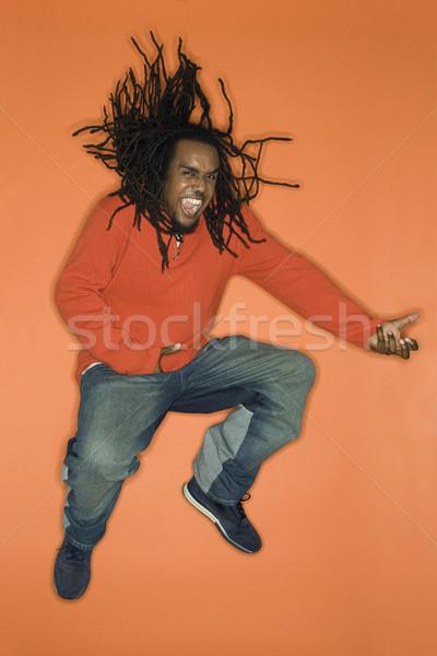 Uomo jumping entusiasmo arancione giocare aria Foto d'archivio © iofoto