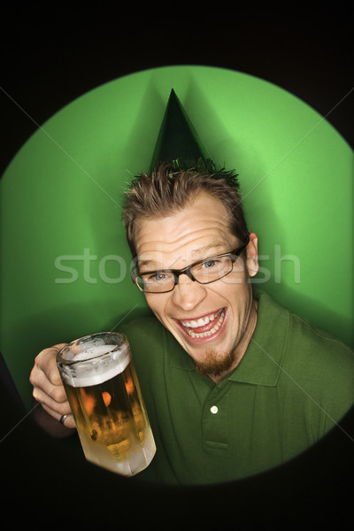 Man holding beer. Stock photo © iofoto