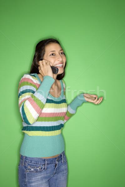Girl talking on cellphone. Stock photo © iofoto