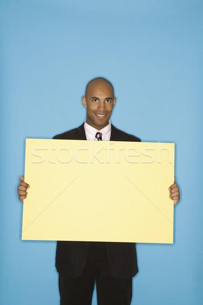 Businessman holding blank sign. Stock photo © iofoto