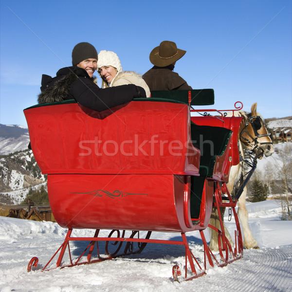 Young couple on sleigh ride. Stock photo © iofoto