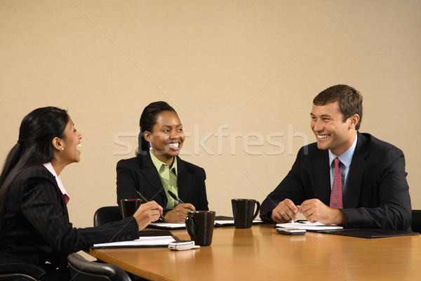 üzletemberek konferencia ül asztal beszél mosolyog Stock fotó © iofoto