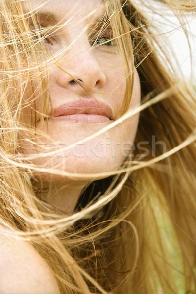 Woman's face in wind. Stock photo © iofoto