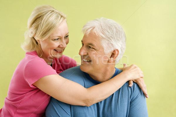 Gelukkig glimlachend paar portret groene Stockfoto © iofoto