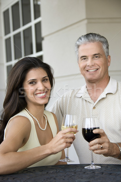 Smiling couple drinking wine. Stock photo © iofoto