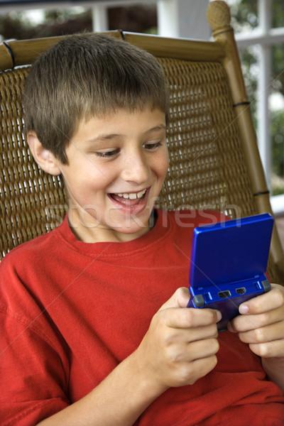 Fiú játszik videojáték kaukázusi mosolyog gyermek Stock fotó © iofoto
