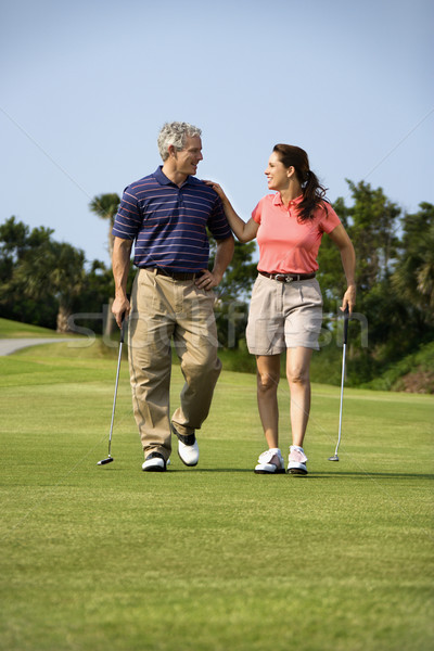 Couple walking on golf course Stock photo © iofoto