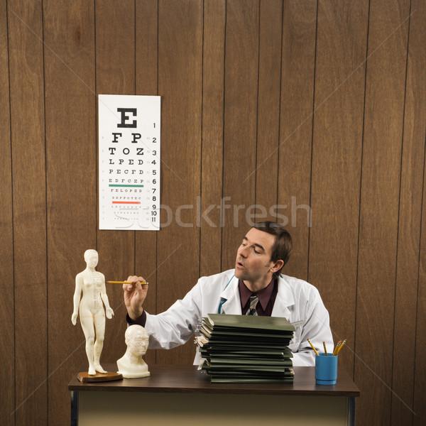 Medico retro ufficio medico di sesso maschile seduta Foto d'archivio © iofoto