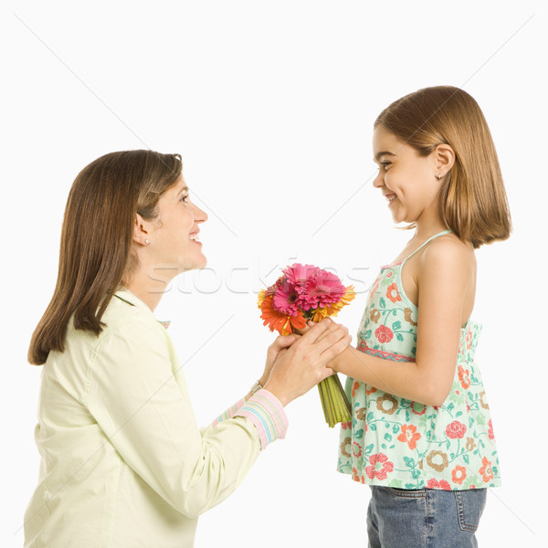 Daughter giving mother flowers. Stock photo © iofoto