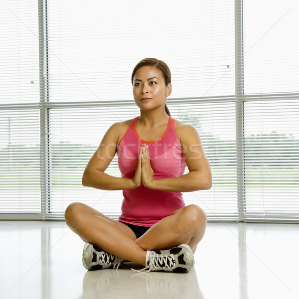 Woman in lotus posture. Stock photo © iofoto