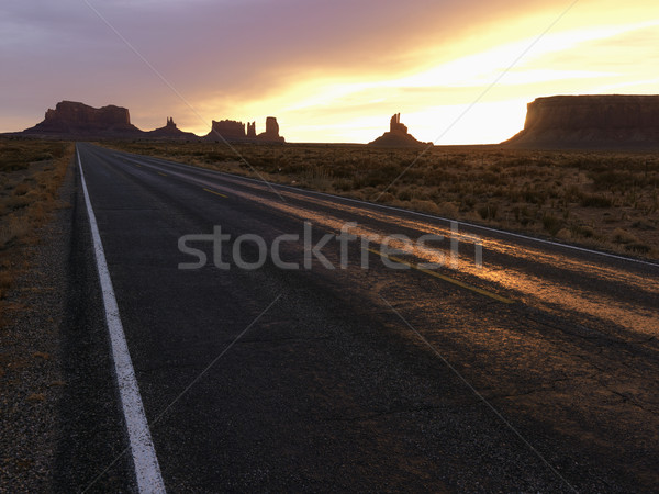 Sunset on highway in Monument Valley. Stock photo © iofoto