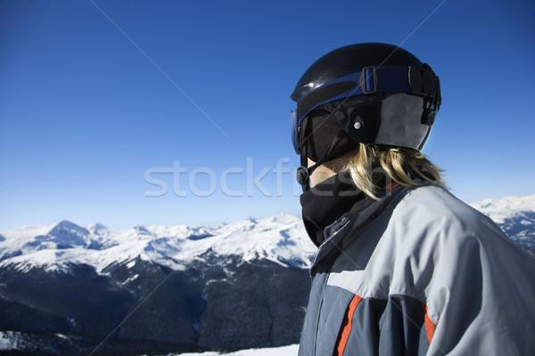 Teen boy snowboarder. Stock photo © iofoto