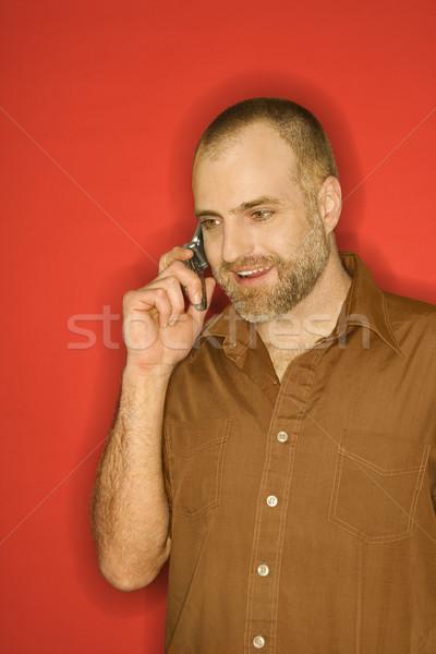 Férfi beszél mobiltelefon portré kaukázusi áll Stock fotó © iofoto