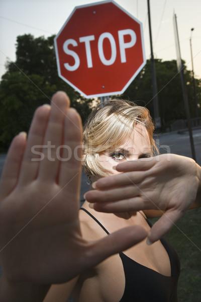 Woman making hand gestures. Stock photo © iofoto