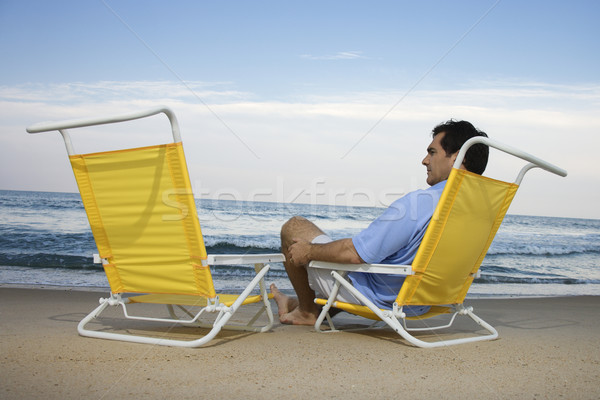Man Sitting on Beach Alone Stock photo © iofoto