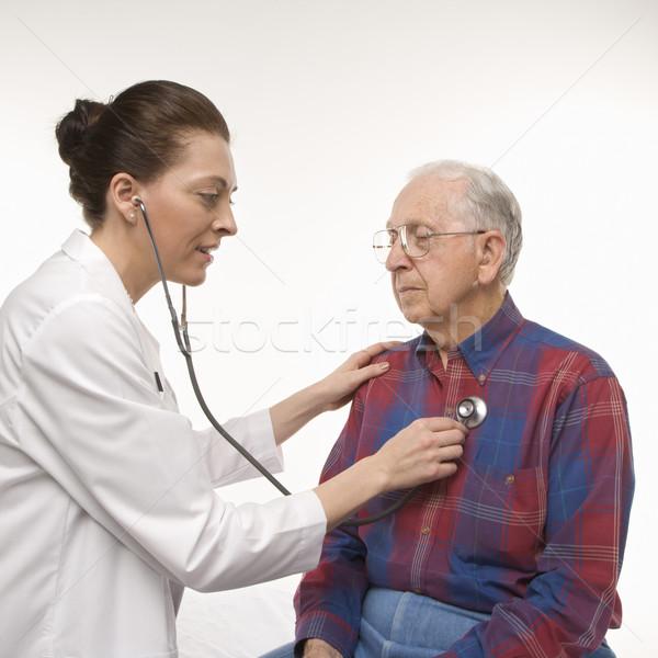 Férfi orvosi vizsgálat kaukázusi női orvos hallgat Stock fotó © iofoto