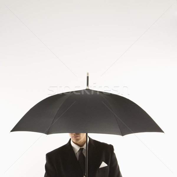 Businessman with umbrella. Stock photo © iofoto