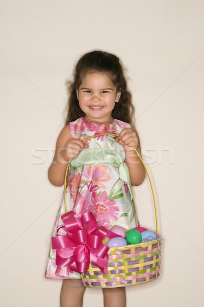Stock photo: Girl holding Easter basket.
