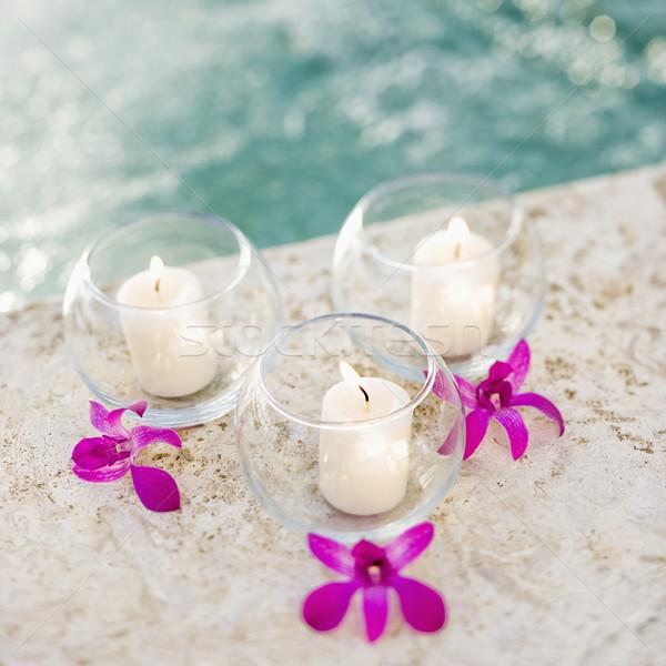 Velas orquídeas três vidro roxo Foto stock © iofoto