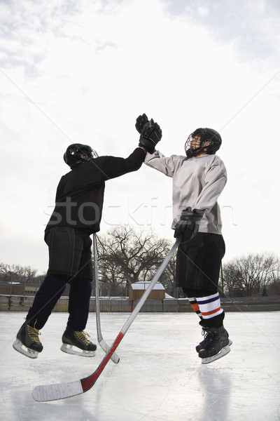 Congratulating teammate. Stock photo © iofoto