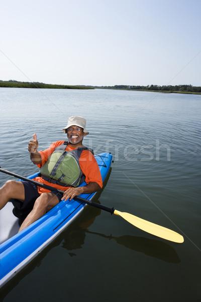 Man in kayak.  Stock photo © iofoto
