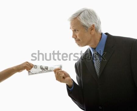 People tugging on money. Stock photo © iofoto