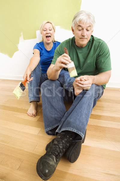 Homem pintar casal parede pintura Foto stock © iofoto