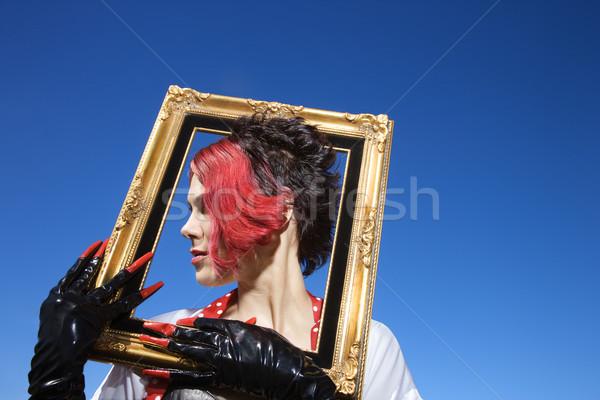 Egyedi nő fiatal felnőtt kaukázusi női tart Stock fotó © iofoto