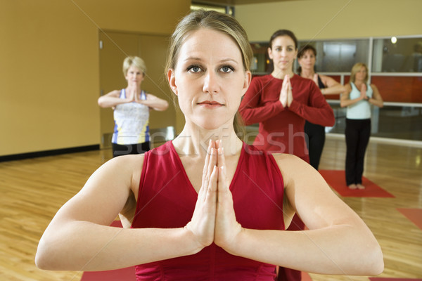 Women in yoga class. Stock photo © iofoto