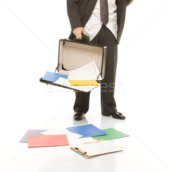 Businessman losing papers. Stock photo © iofoto