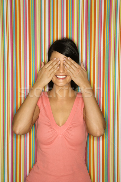 Smiling woman covering eyes. Stock photo © iofoto