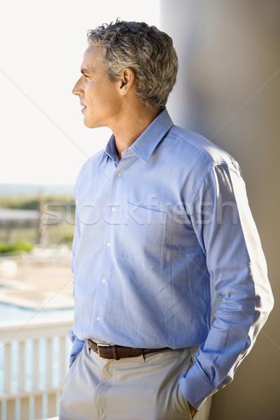 Adam bakıyor dalgın portre ayakta sundurma Stok fotoğraf © iofoto