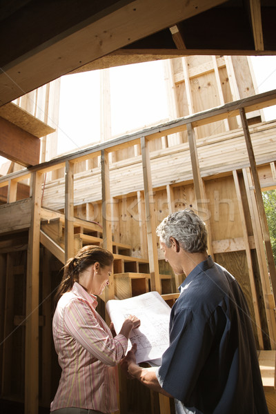 Couple looking at new house. Stock photo © iofoto