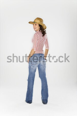 Cowgirl blowing imaginary gun. Stock photo © iofoto