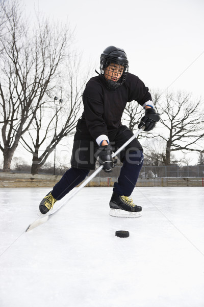 Stock photo: Boy playing ice hockey.