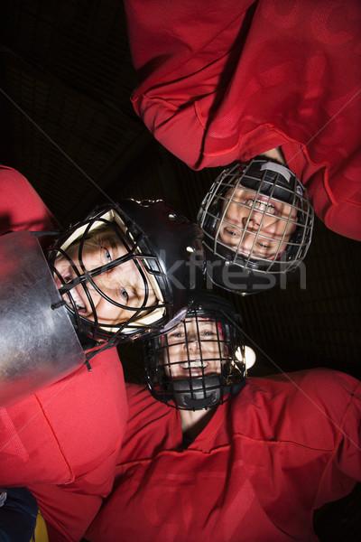 Women hockey player huddle. Stock photo © iofoto