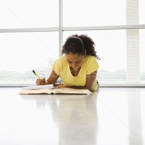 Girl doing schoolwork. Stock photo © iofoto