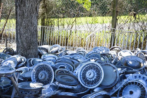 Piles of hubcaps on ground. Stock photo © iofoto