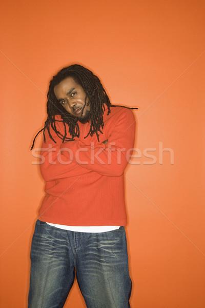 Uomo atteggiamento braccia indossare arancione abbigliamento Foto d'archivio © iofoto