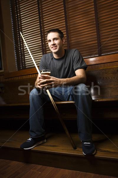 Man holding pool stick. Stock photo © iofoto
