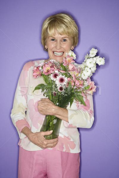 Woman holding flower bouquet. Stock photo © iofoto