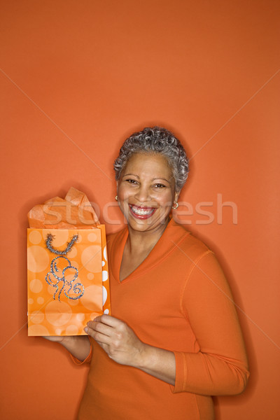 Woman holding gift bag. Stock photo © iofoto