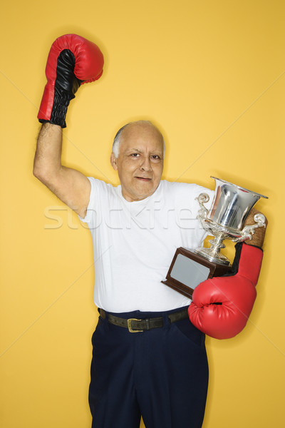 Mature man with trophy. Stock photo © iofoto