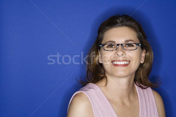 Woman wearing eyeglasses. Stock photo © iofoto