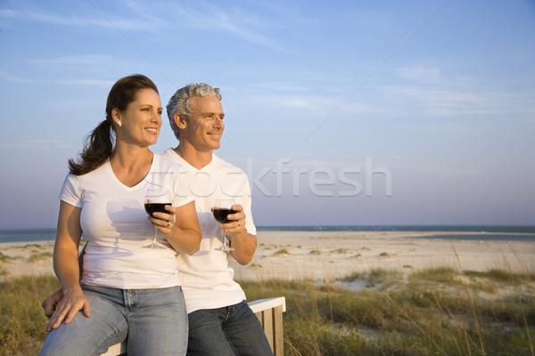 Couple Drinking Wine on Beach Stock photo © iofoto