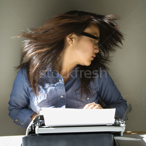Woman with typewriter. Stock photo © iofoto