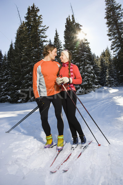 Cross Country Snow Skiiers Smiling at Each Other Stock photo © iofoto